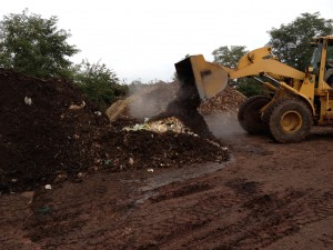 Front loader moving food waste